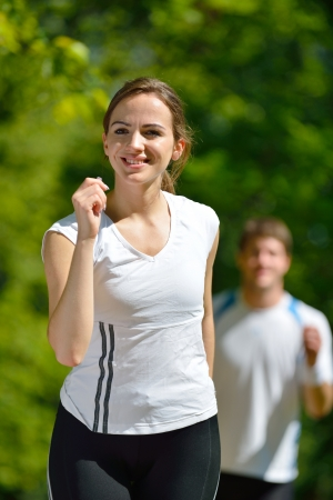 Young couple jogging in park at morning. Health and fitness. Stock Photo - 14703493