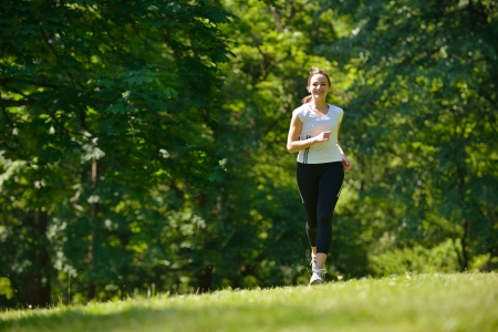 Young couple jogging in park at morning. Health and fitness. photo