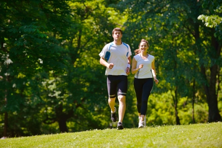 fit couple: Young couple jogging in park at morning. Health and fitness.