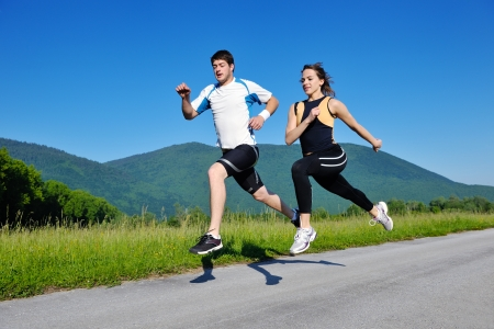 Young couple jogging in park at morning. Health and fitness. Stock Photo - 14739302