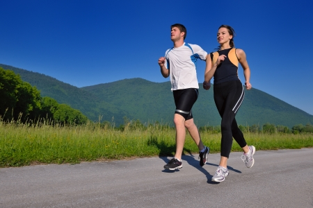 Young couple jogging in park at morning. Health and fitness. Stock Photo - 14767116