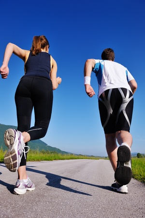 Young couple jogging in park at morning. Health and fitness. Stock Photo - 14808016