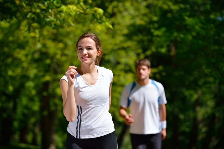 Young couple jogging in park at morning. Health and fitness. Stock Photo - 14739391