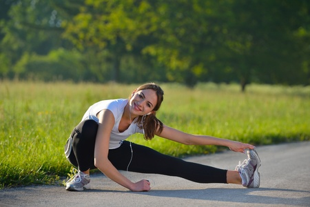 healthy young woman stretching before Fitness and Exercise photo