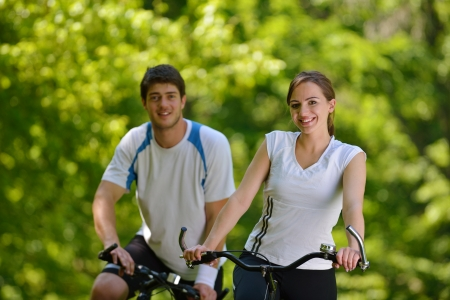 Young couple jogging in park at morning. Health and fitness. Stock Photo - 15037147