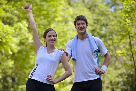 sport leisure: Young couple jogging in park at morning. Health and fitness.