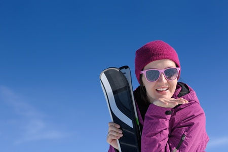 winter woman ski sport fun travel snow photo