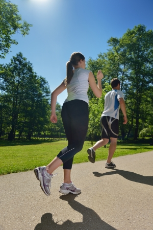 Young couple jogging in park at morning  Health and fitness concept Stock Photo - 17632996