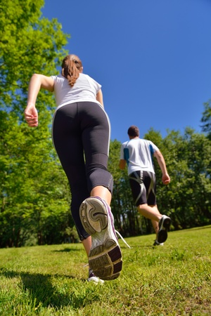 Young couple jogging in park at morning. Health and fitness concept Stock Photo - 15097006