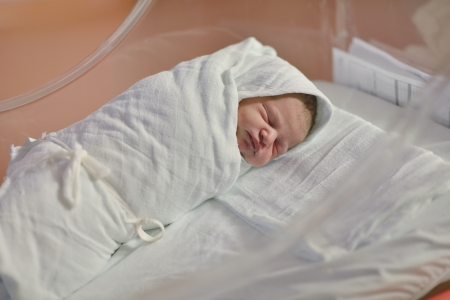 cute healthy new born baby portrait in hospital photo