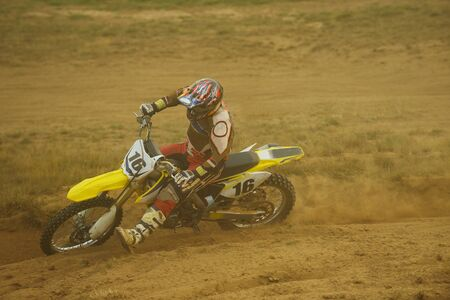 motocross bike in a race representing concept of speed and power in extreme man sport Stock Photo - 15080541