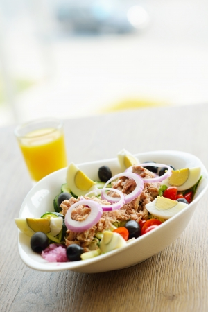 healthy food salad wiht vegetables and tuna fish photo