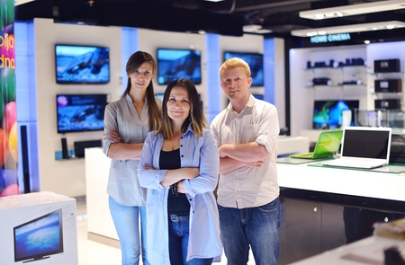 people in consumer electronics  retail store looking at latest laptop, television and photo camera to buy Stock Photo - 15241249