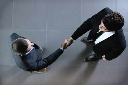 business partner: business people shaking hands make deal and sign contract