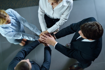 business people group joining hands and representing concept of friendship and teamwork,  low angle view Stock Photo - 15276945