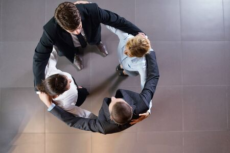 business people group joining hands and representing concept of friendship and teamwork,  low angle view Stock Photo - 15276968