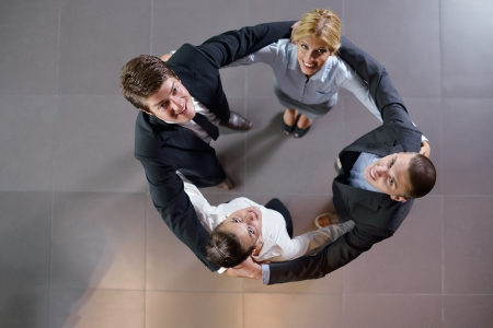 business people group joining hands and representing concept of friendship and teamwork,  low angle view Stock Photo - 15276907