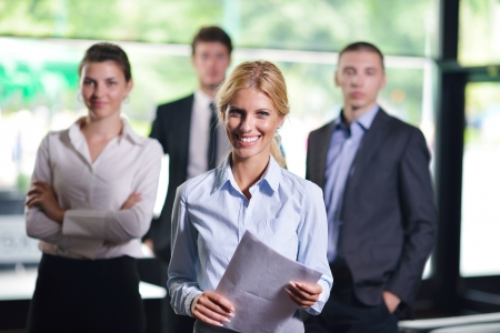 manager: Group of happy young  business people in a meeting at office Stock Photo