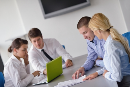 Group of happy young  business people in a meeting at office Stock Photo - 15338429