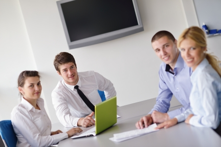 Group of happy young  business people in a meeting at office photo