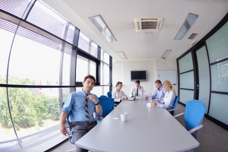 Group of happy young  business people in a meeting at office Stock Photo - 15276966