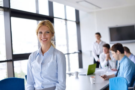 business woman  with her staff,  people group in background at modern bright office indoors Stock Photo - 15338433