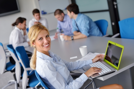 business woman  with her staff,  people group in background at modern bright office indoors Stock Photo - 15300932