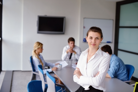 business woman  with her staff,  people group in background at modern bright office indoors Stock Photo - 15338440