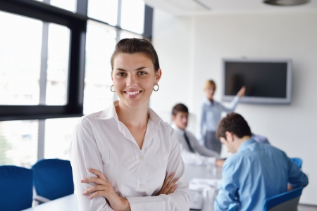 business woman  with her staff,  people group in background at modern bright office indoors Stock Photo - 15276671