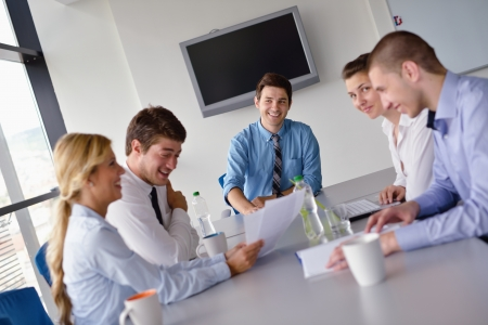Group of happy young  business people in a meeting at office Stock Photo - 15338448