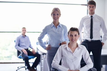 business woman  with her staff,  people group in background at modern bright office indoors Stock Photo - 15276685