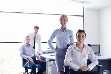 business woman  with her staff,  people group in background at modern bright office indoors Stock Photo - 15276719