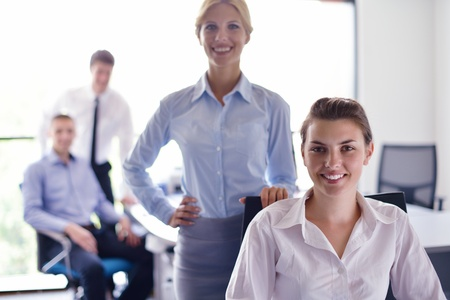 business woman  with her staff,  people group in background at modern bright office indoors Stock Photo - 15276785