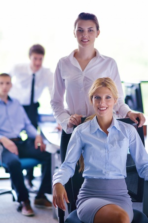 business woman  with her staff,  people group in background at modern bright office indoors Stock Photo - 15276778