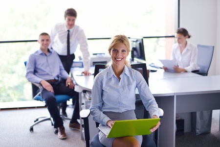 business woman  with her staff,  people group in background at modern bright office indoors Stock Photo - 15300873