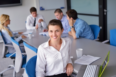 business woman  with her staff,  people group in background at modern bright office indoors Stock Photo - 15301057