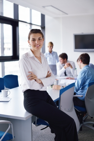 business woman  with her staff,  people group in background at modern bright office indoors Stock Photo - 15301110