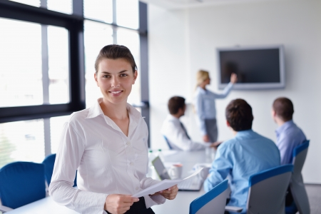 business woman  with her staff,  people group in background at modern bright office indoors Stock Photo - 15301068