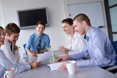 group discussions: Group of happy young  business people in a meeting at office Stock Photo