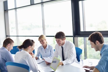 Group of happy young  business people in a meeting at office Stock Photo - 15301069