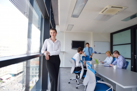executive office: business woman  with her staff,  people group in background at modern bright office indoors Stock Photo
