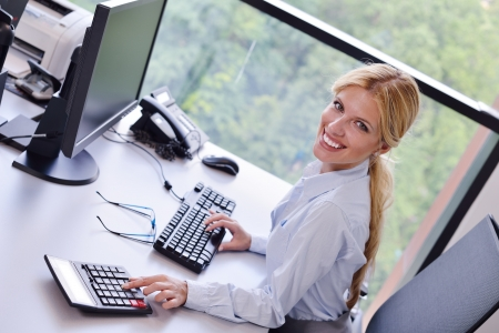 Portrait of a beautiful business woman working on her desk in an office environment Stock Photo - 15301105