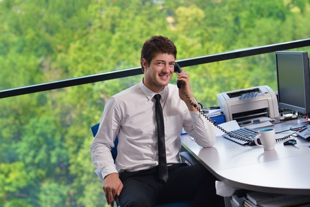 happy young business  man work in modern office on computer Stock Photo - 15301143