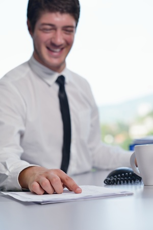 happy young business  man work in modern office on computer Stock Photo - 15301042