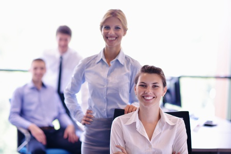 business woman  with her staff,  people group in background at modern bright office indoors Stock Photo - 15301043