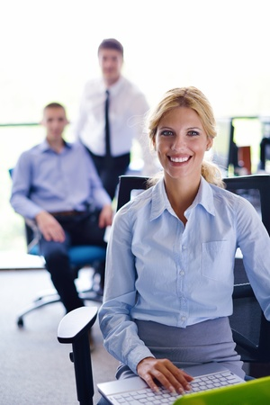business woman  with her staff,  people group in background at modern bright office indoors Stock Photo - 15301082