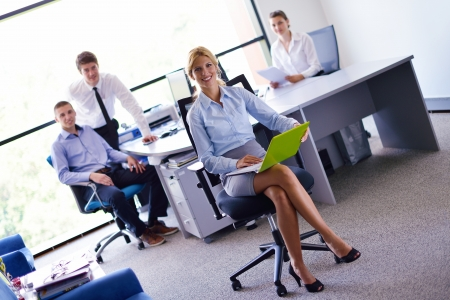 business woman  with her staff,  people group in background at modern bright office indoors Stock Photo - 15301135