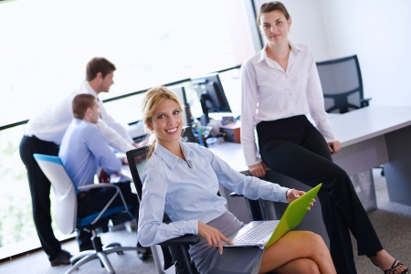 business woman  with her staff,  people group in background at modern bright office indoors Stock Photo - 15301108
