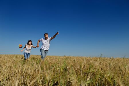 happy young couple in love have romance and fun at wheat field in summer Stock Photo - 15558864