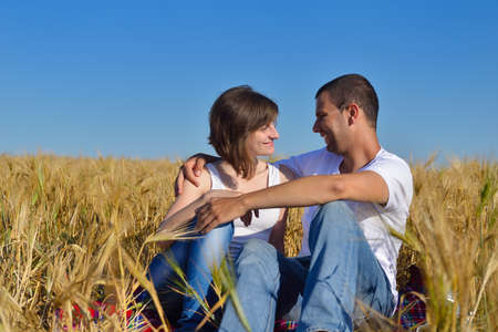 happy young couple in love have romance and fun at wheat field in summer Stock Photo - 15558866